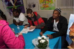 Free Minds Poets sign autographs
