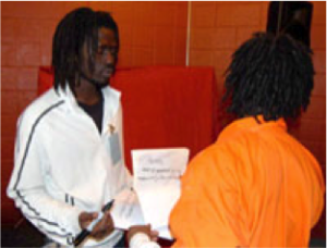 Emmanuel Jal with Book Club member