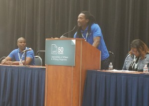 Terrell speaking at a podium