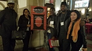 Free Minds staff and Poet Ambassadors at a sign for the Inside-Out Conference