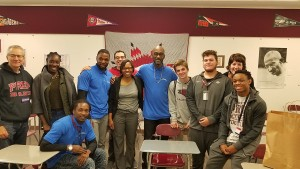 Free Minds staff and Poet Ambassadors with students