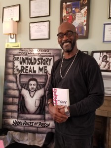 "Rod stands in front of a board that says ""The Untold Story of the Real Me"""