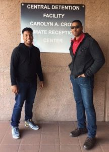 Two men stand outside the DC Jail