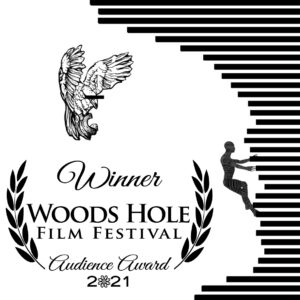 """A black and white graphic with text that reads """"Winner Woodshole Film Festival Audience Award 2021,"""" with laurels on either side. On the right, a drawing in the style of the film's animation, shows a figure climbing up a series of bars. In the upper left, there is a drawing of a large bird with its wings raised and a black bar across its eyes."""